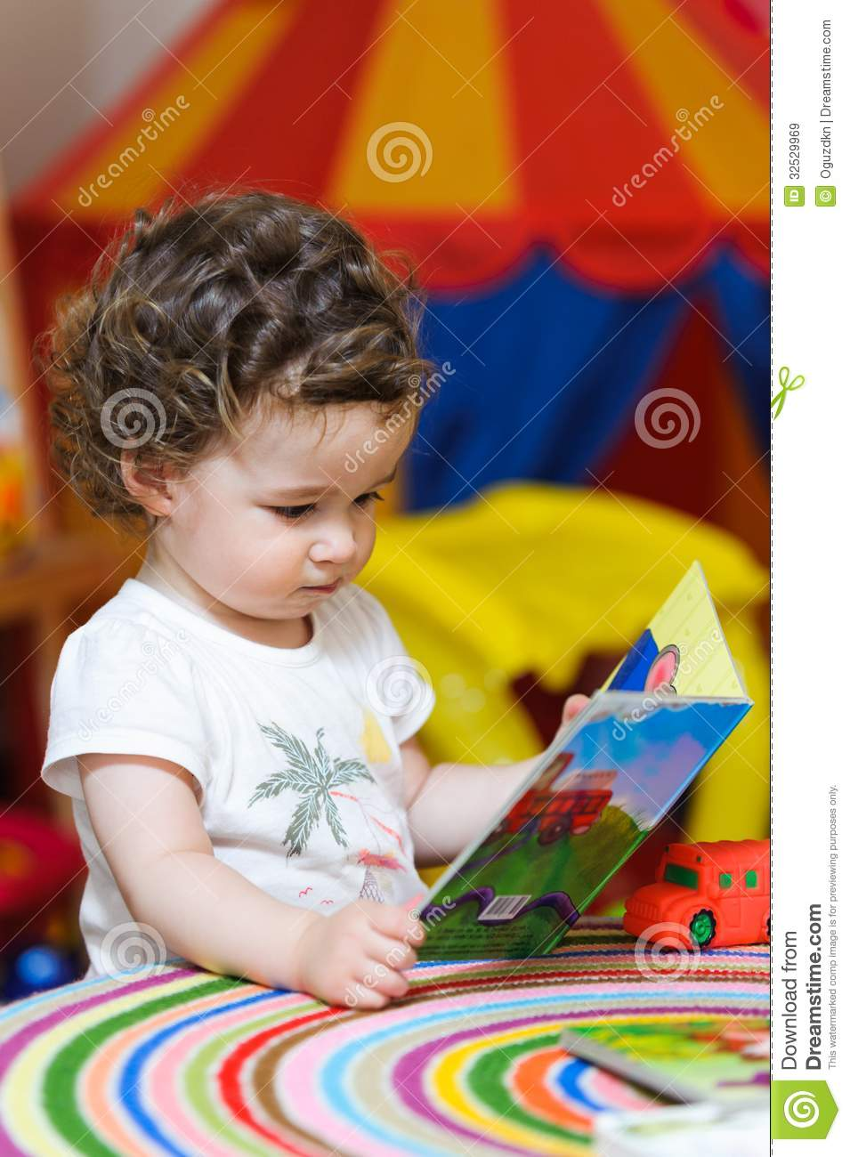 Preschool Baby Girl Looking A Picture Book Royalty Free Stock Images - Image: 32529969