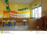 Preschool Classroom With Chairs And Table With Drawings ...