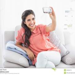 Sitting Pretty Sofas How To Clean Stains From Velvet Sofa Brunette On Her Taking A Picture Of