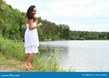 Girl Walking by Water