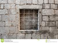 Prison Wall With Metal Window Bars Stock Photo