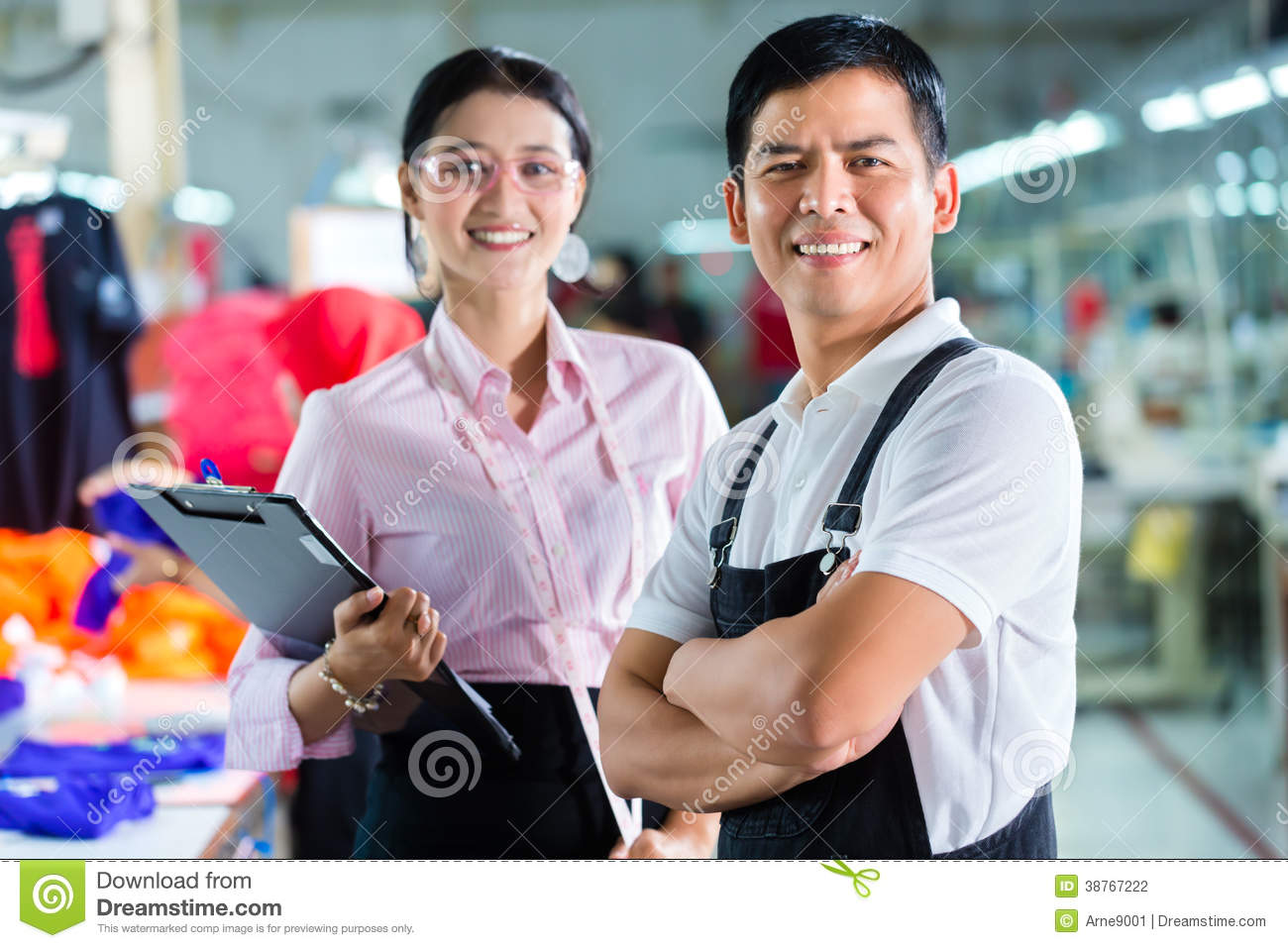Production Manager And Designer In Asian Factory Stock