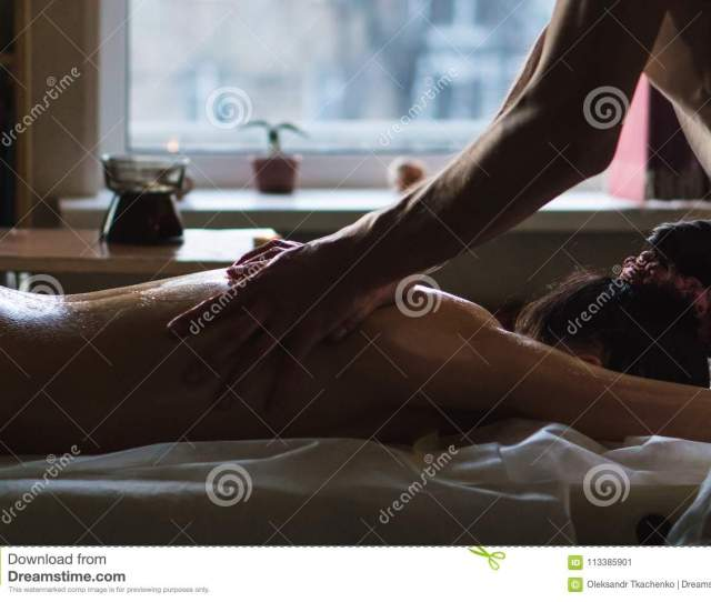 Professional Masseur Doing Deep Tissue Oiled Back Massage To A Girl At Ayurveda Massage Session