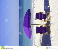 Purple Beach Chairs And Umbrella Stock Image