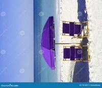 Purple Beach Chairs And Umbrella Stock Image - Image: 11018417