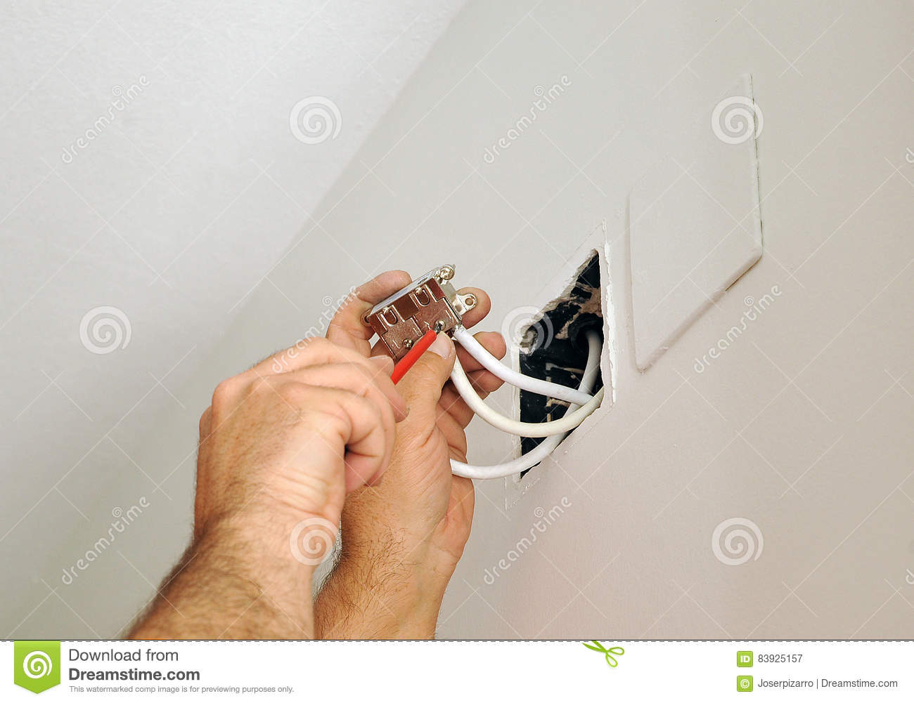 hight resolution of a qualified electrician doing the wiring connections to the television antenna in the junction box for