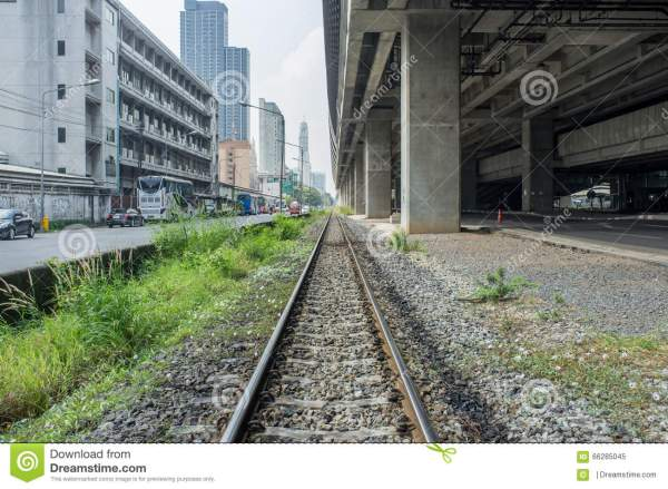 Railway Track With Background Of Building Road And Train
