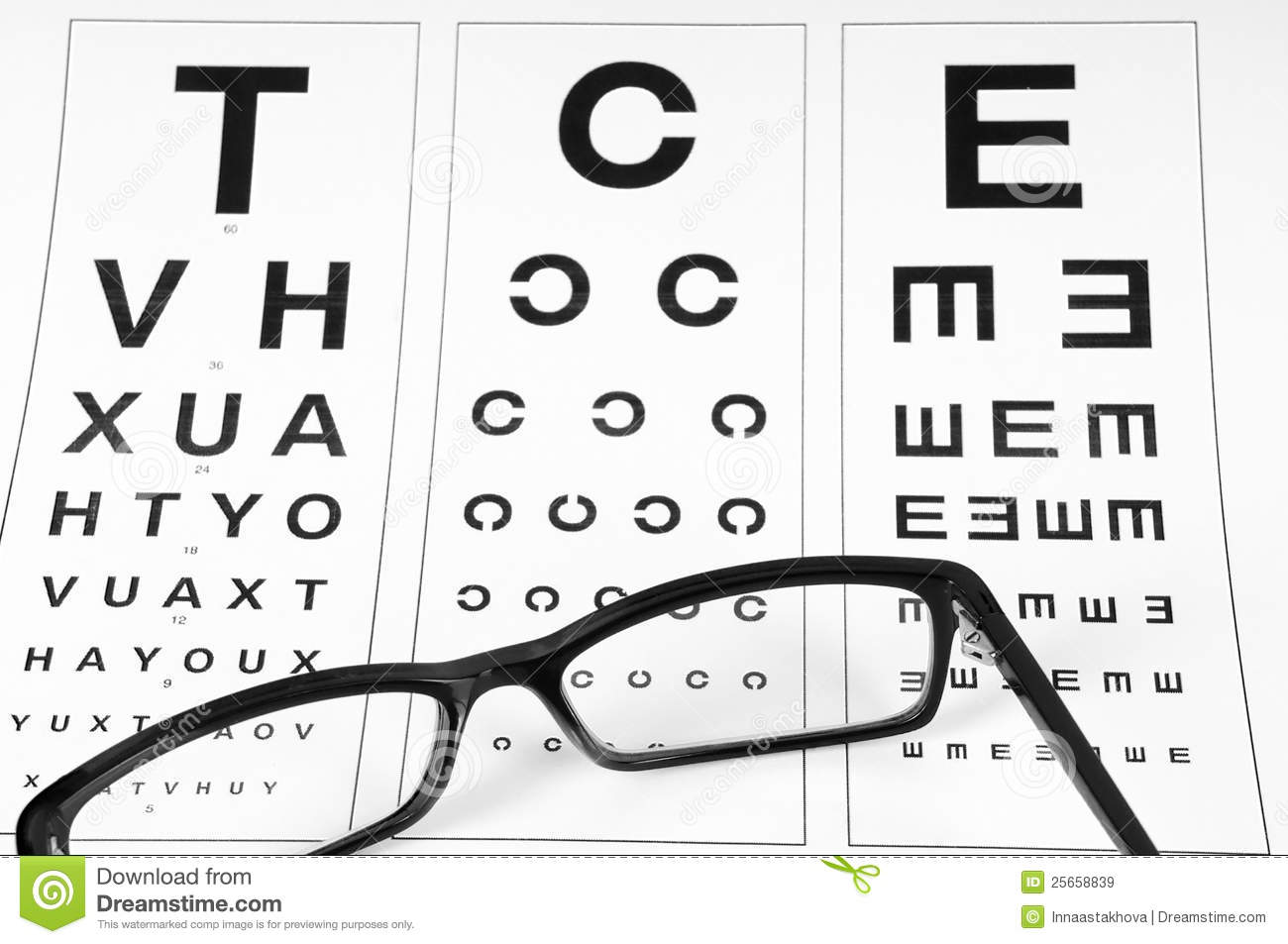 Reading Eyeglasses And Eye Chart Royalty Free Stock Images