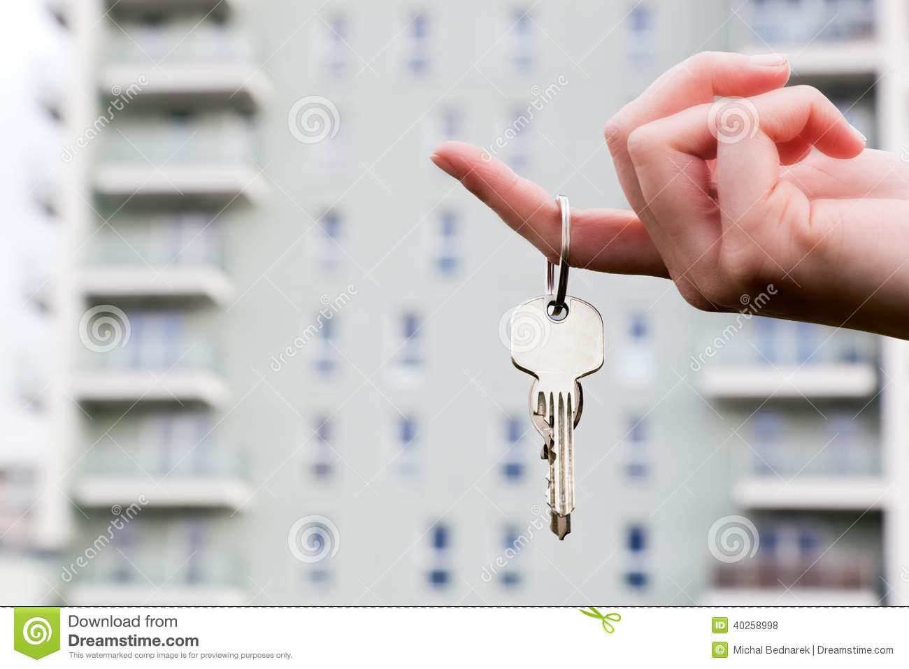 A Real Estate Agent Holding Keys To A New Apartment In Her