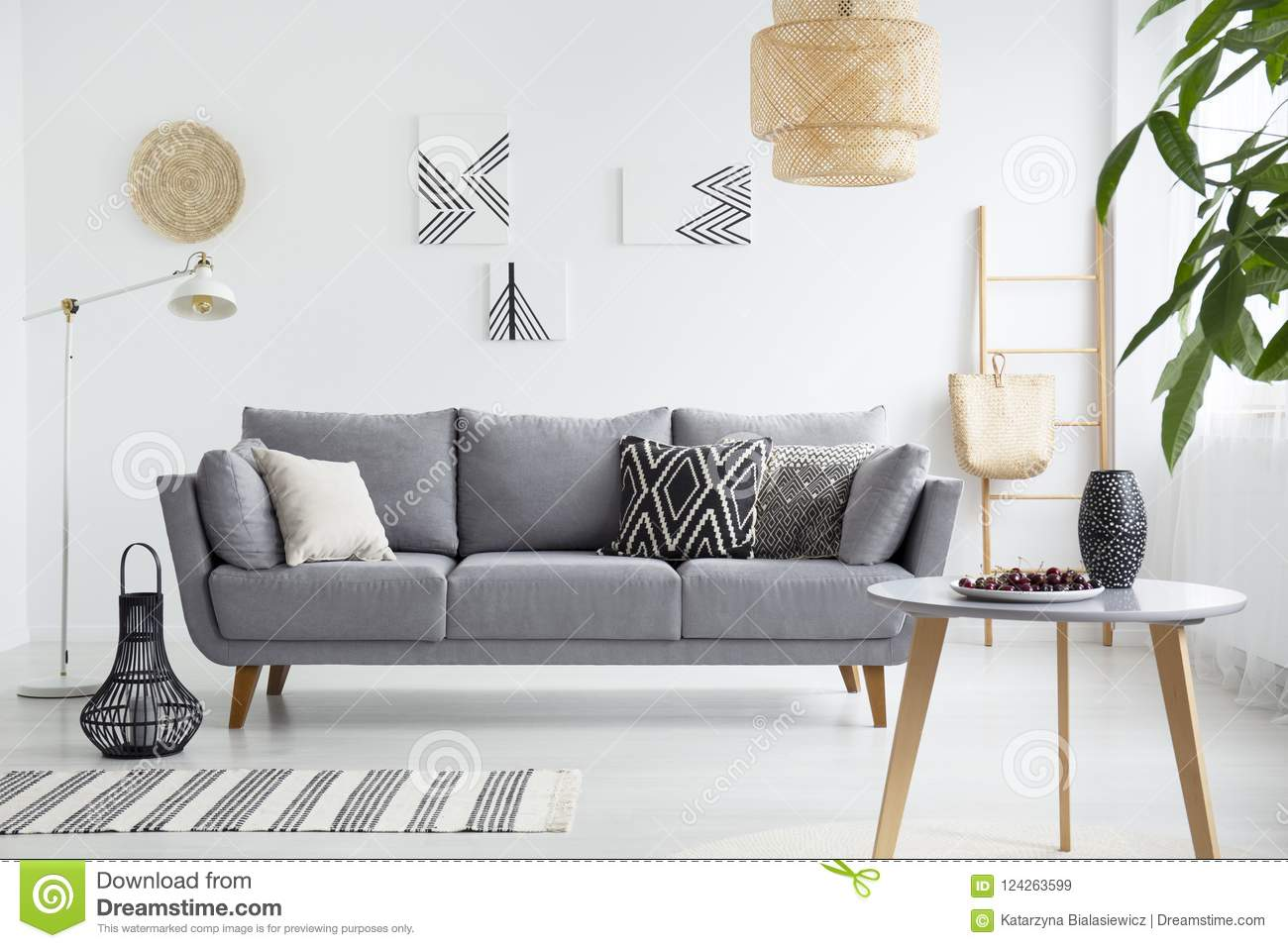 living room cushions affordable wall decor real photo of a scandi interior with on gray couch cherries