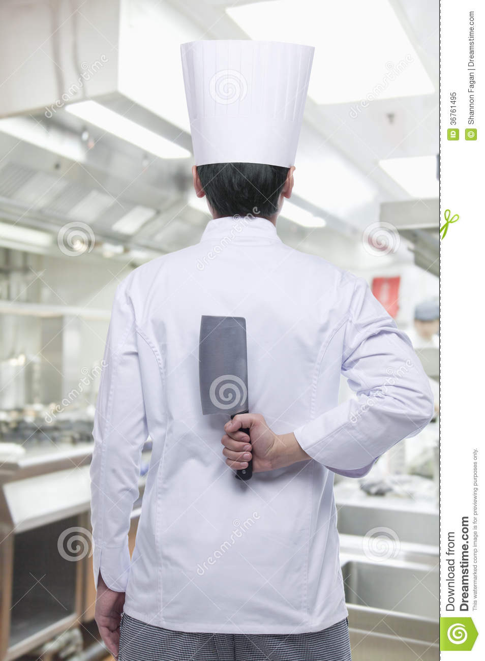 Rear View Of Chef With Knife Behind His Back Royalty Free
