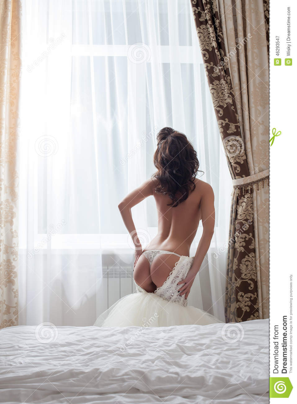 Rear View Of Sexy Naked Bride In Hotel Room Stock Photo