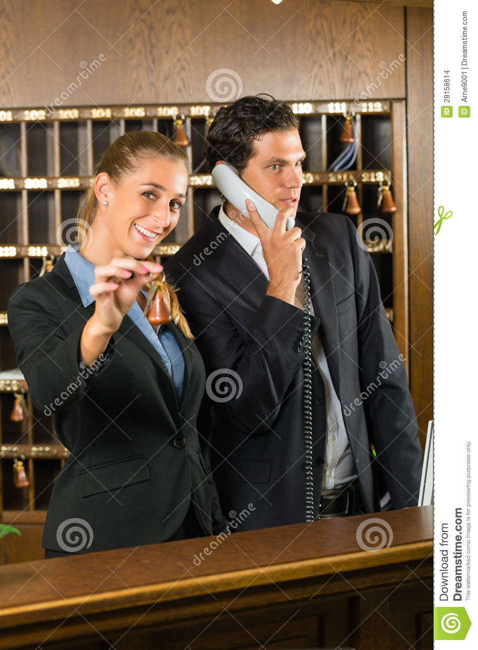 Reception In Hotel  Man And Woman Stock Photo  Image of colleague black 28158614