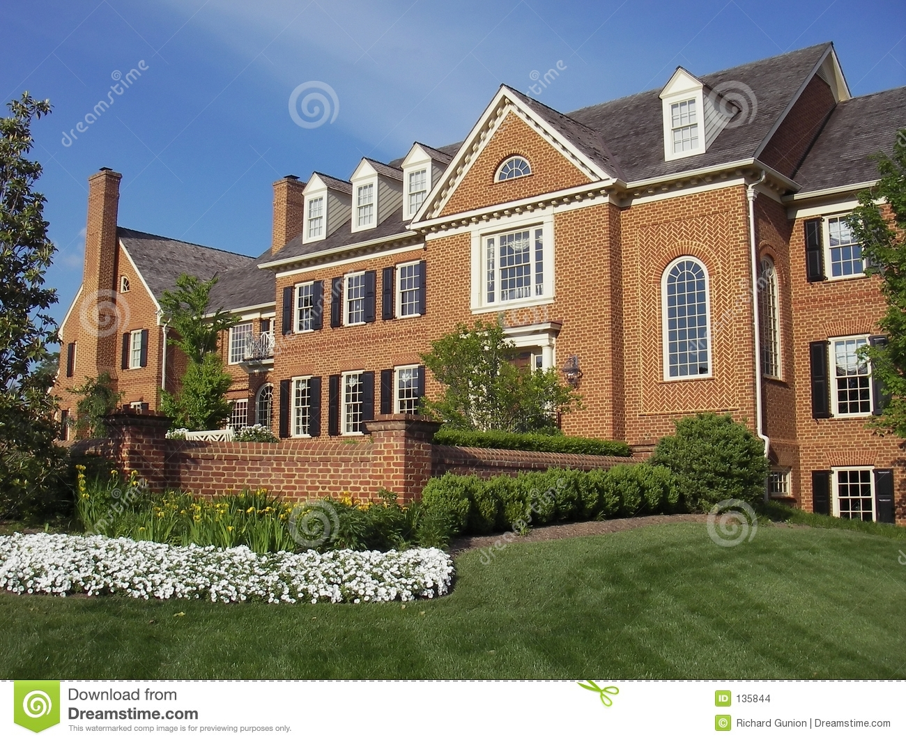of red brick mansion in a montgomery county maryland neighborhood