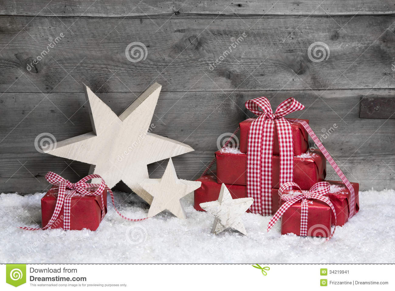 Red Christmas Gifts With Wooden Starts On Grey Wooden