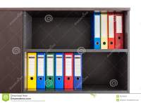 Red, Green, Blue And Yellow Office Folders Stock Photo