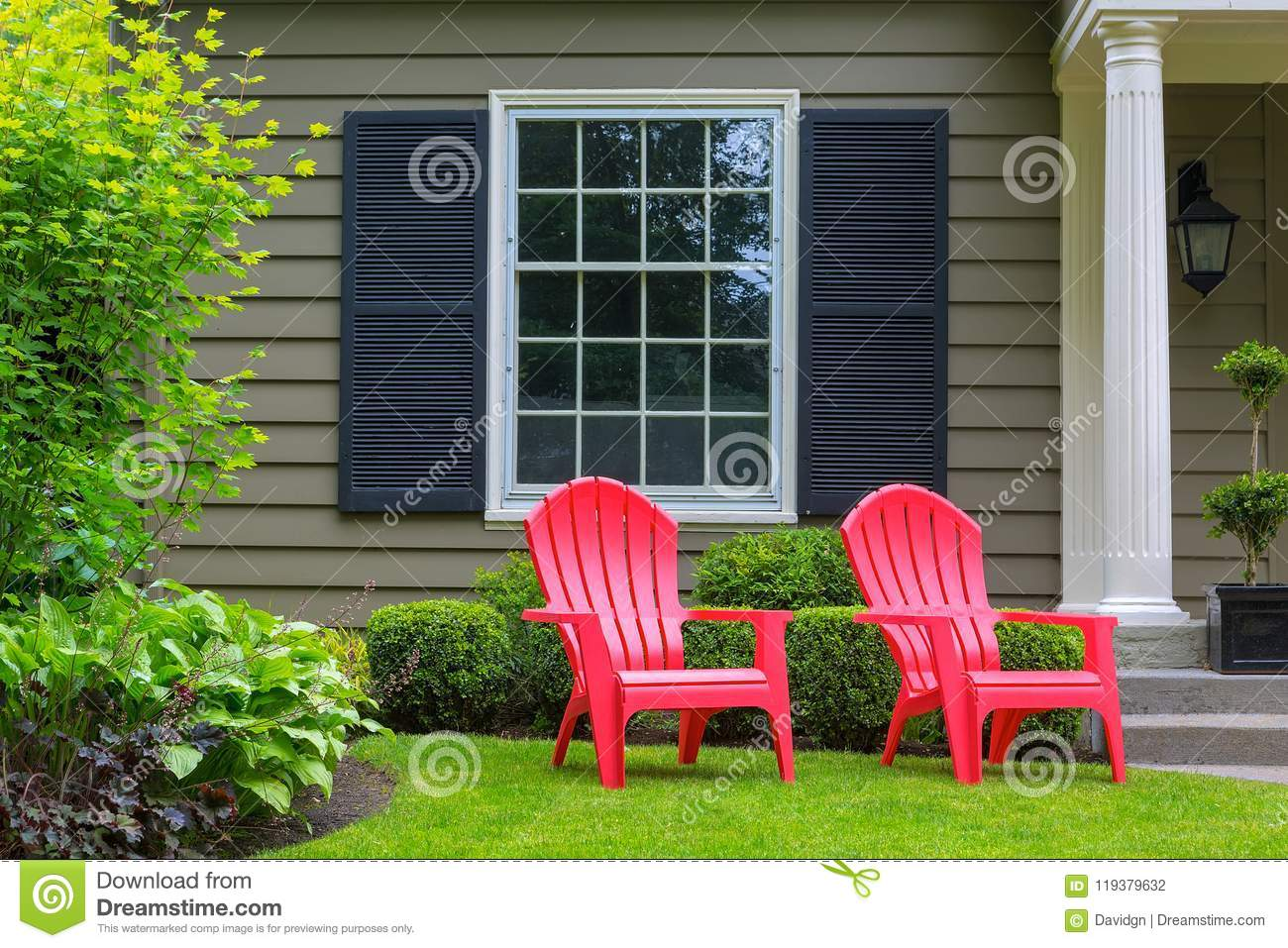 Red Patio Chairs Red Outdoor Patio Chairs On Front Yard Green Lawn Stock Photo