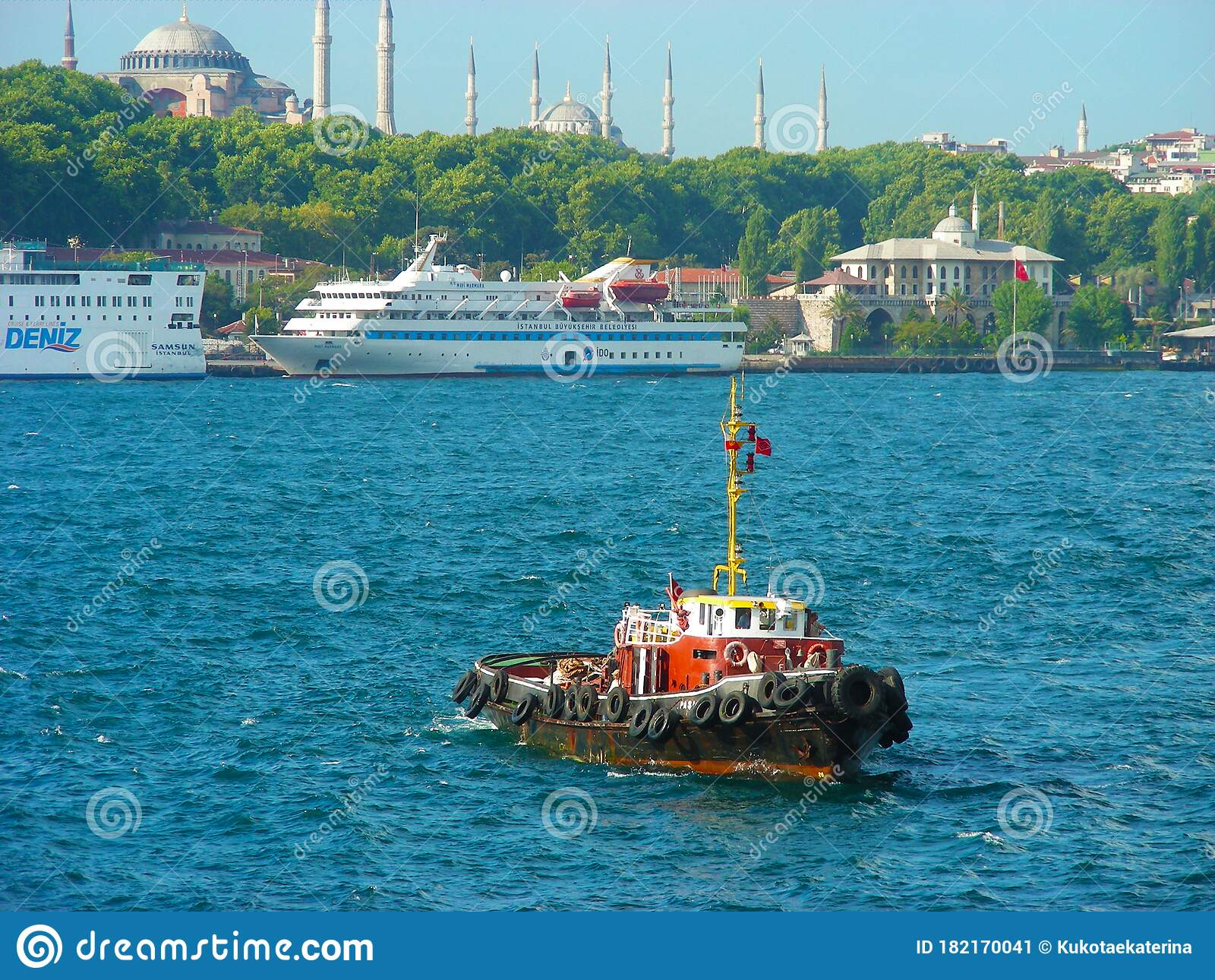 red ship tugboat sailing in the blue sea breaking the waves editorial photo image of cargo carrier 182170041