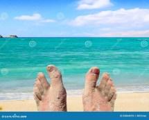 Feet Relaxing On Beach