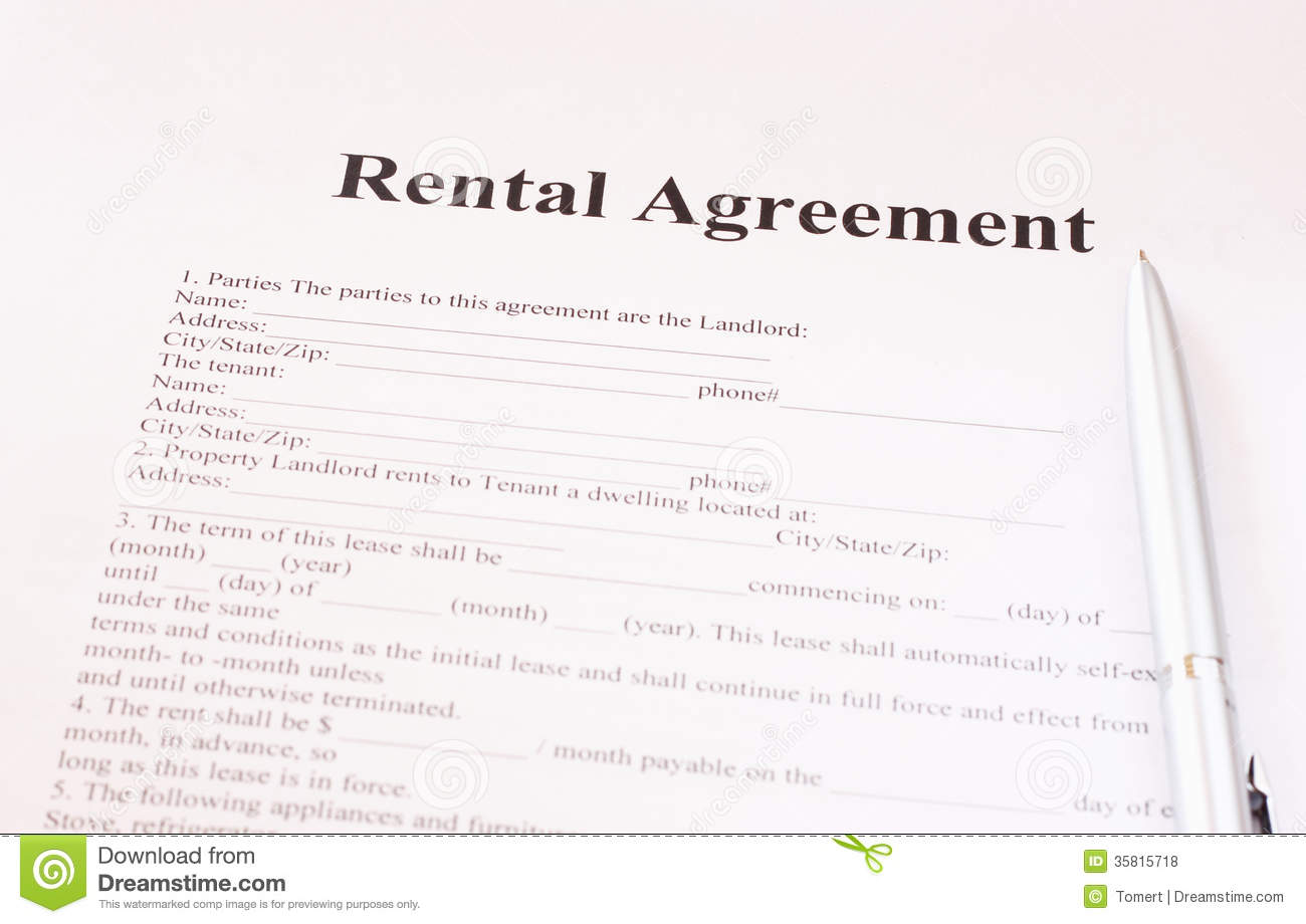 Rental Agreement Form With Pen Royalty Free Stock Photos