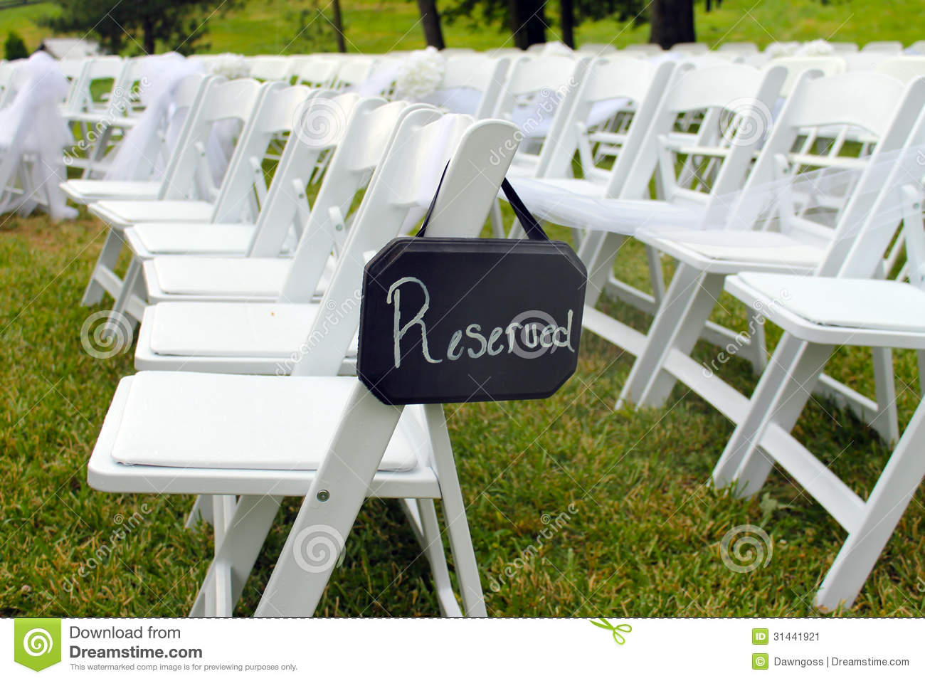 white chairs for wedding black and paisley accent chair reserved sign at outdoor stock image 31441921