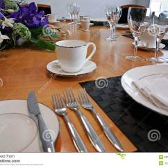 6 Chair Dining Table Two Person Swing Restaurant Setup With Cut Flowers Royalty Free Stock Image - Image: 8914416