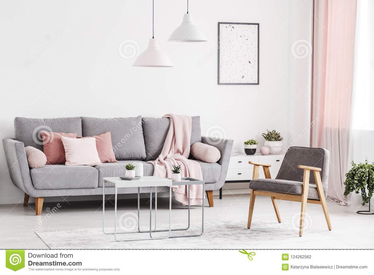 retro living room coffee table design ideas brown leather couch armchair grey sofa with pink pillows and tables in an elegant interior real photo concept