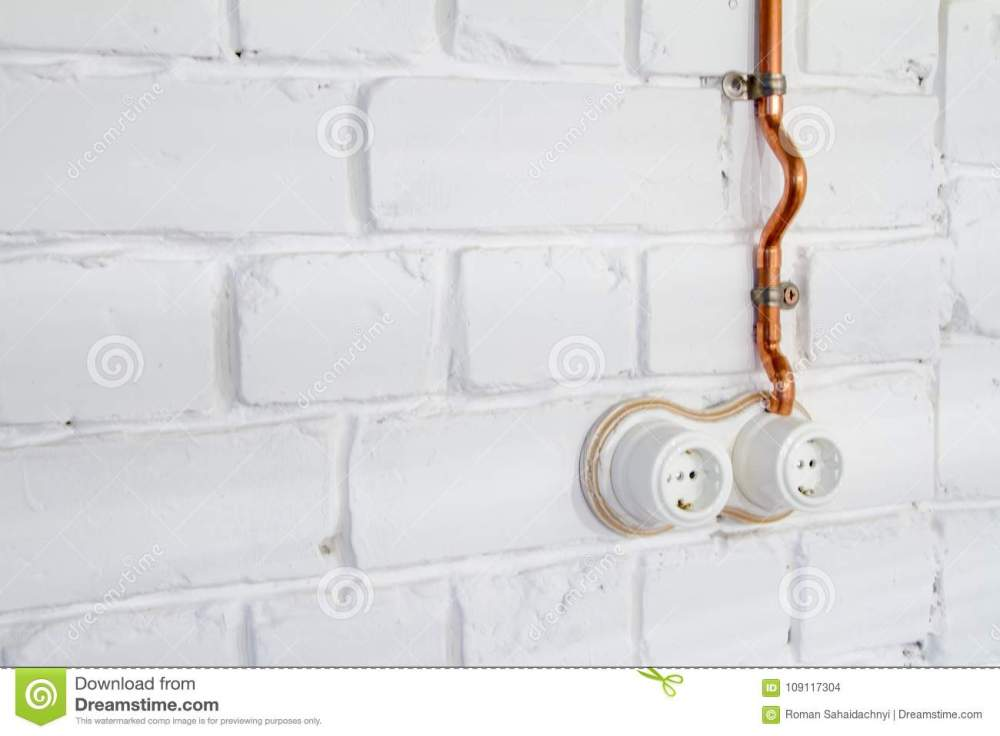 medium resolution of a vintage outlet and electrical wiring in a copper tube