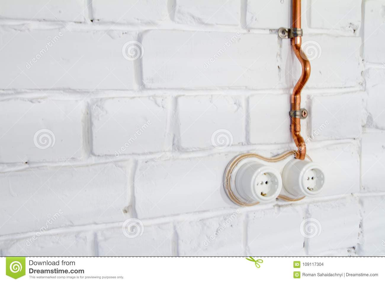 hight resolution of a vintage outlet and electrical wiring in a copper tube