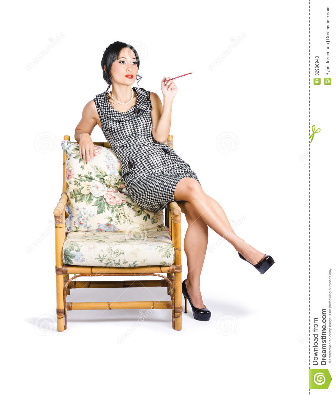 woman sitting in chair mat home depot retro on lounge with cigarette holder stock