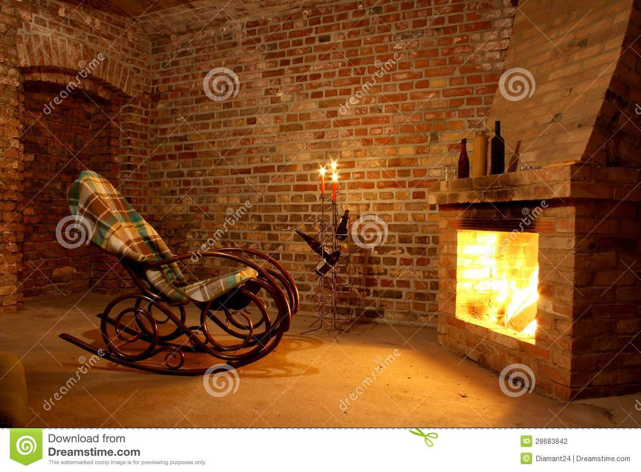 Rocking Chair By The Fireplace In Brick Room Stock