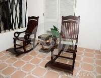 White Wooden Rocking Chair On Front Porch At Home Stock ...