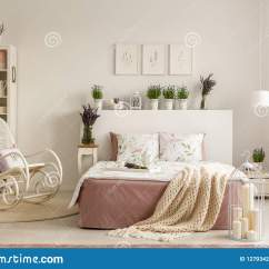 Bedroom Chair With Blanket Upholstered Swivel Rocker Chairs Rocking Next To Bed In Provencal Interior Plants And Posters