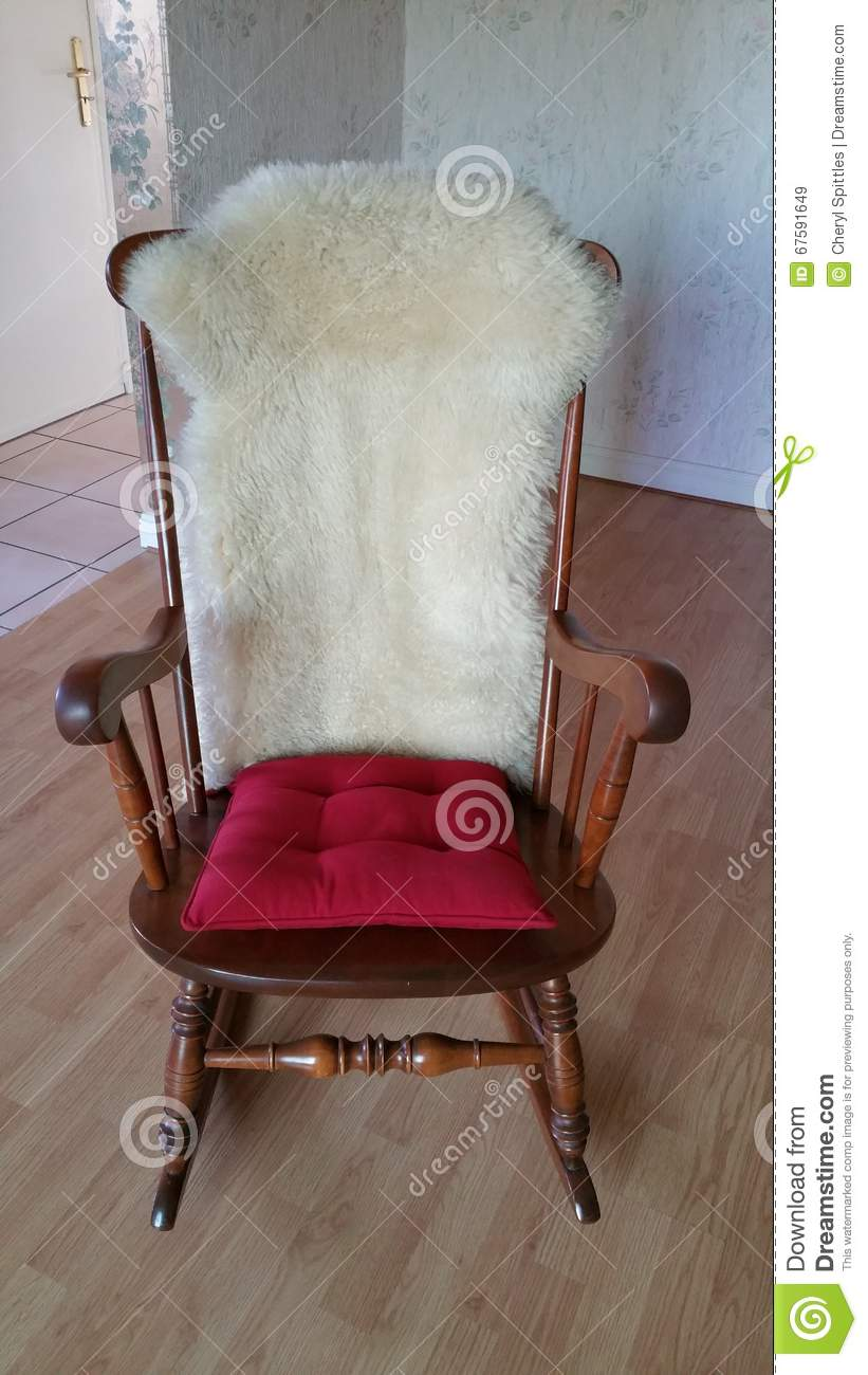 Rocking Chair With Red Cushion On Seat And Sheepskin On