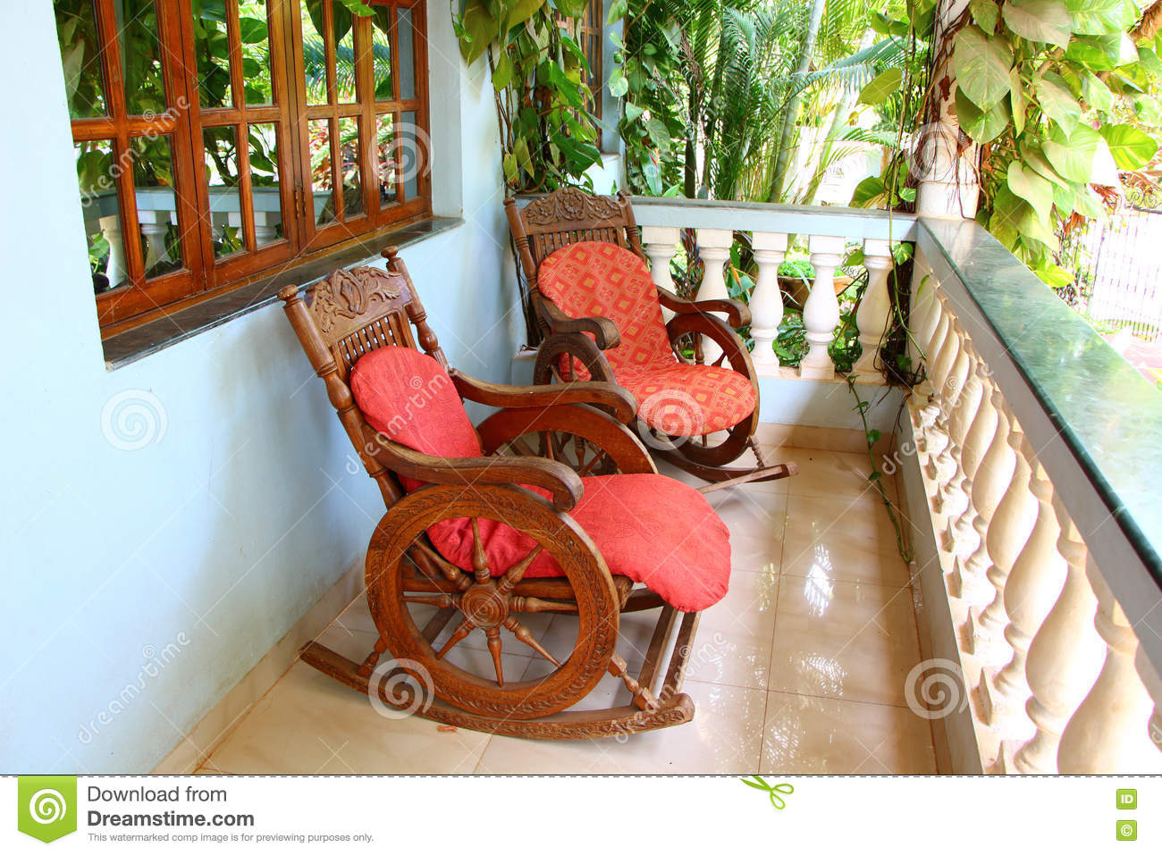 floor rocking chair india safavieh dining chairs target on the veranda stock photo image of resort south palm terrace in hotel marble furniture porch