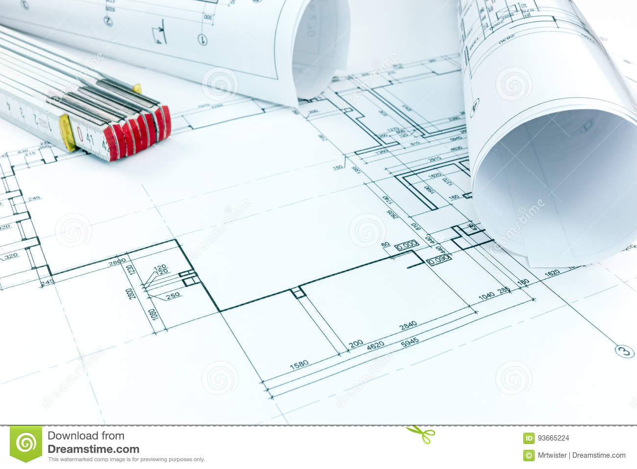 hight resolution of rolls of architectural house plans with wooden folding ruler on desk