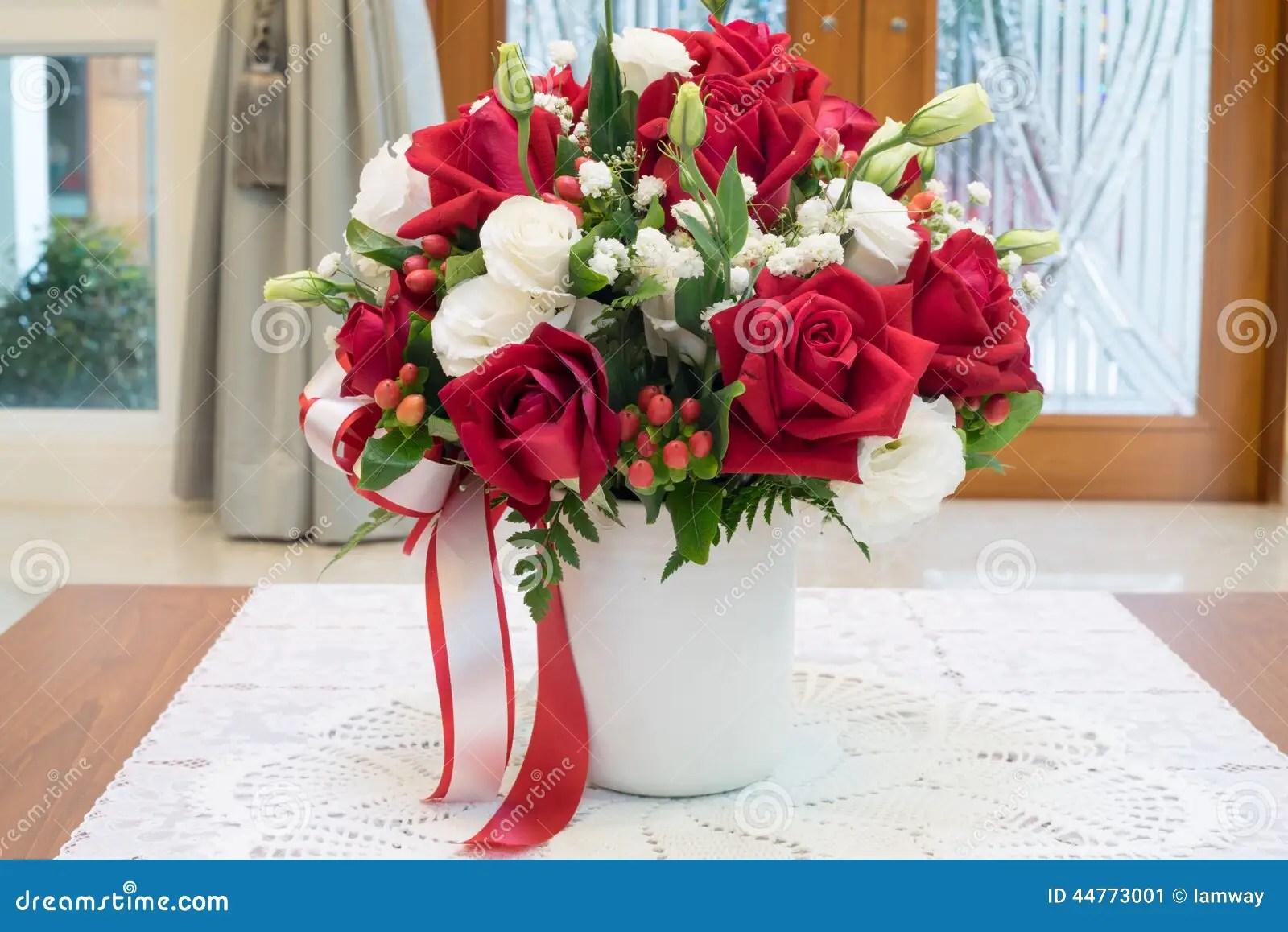 Roses Flowers Bouquet Inside Vase On Desk In House