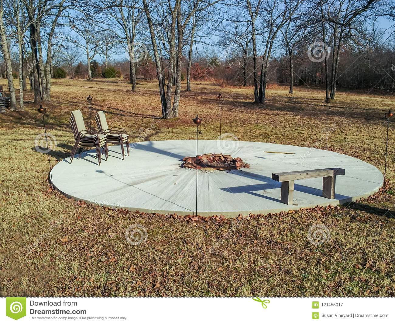 https www dreamstime com round cement patio fire pit middle wooden bench stacked chairs metal tiki torches deserted wi winter out large image121455017