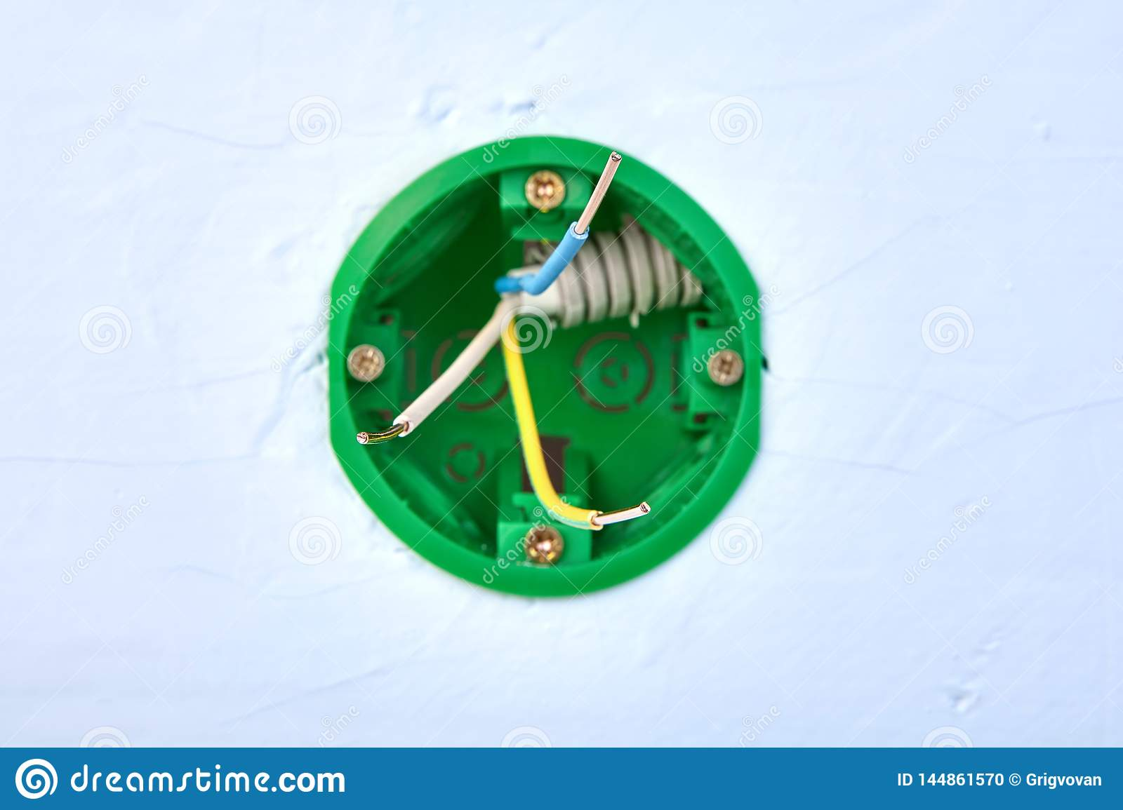 hight resolution of round electrical box for wall light switch with copper wires inside electric installation work