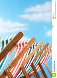 Row Of Deck Chairs On Beach Stock Photography - Image ...