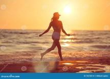 Barefoot Running Beach Sunset Stock