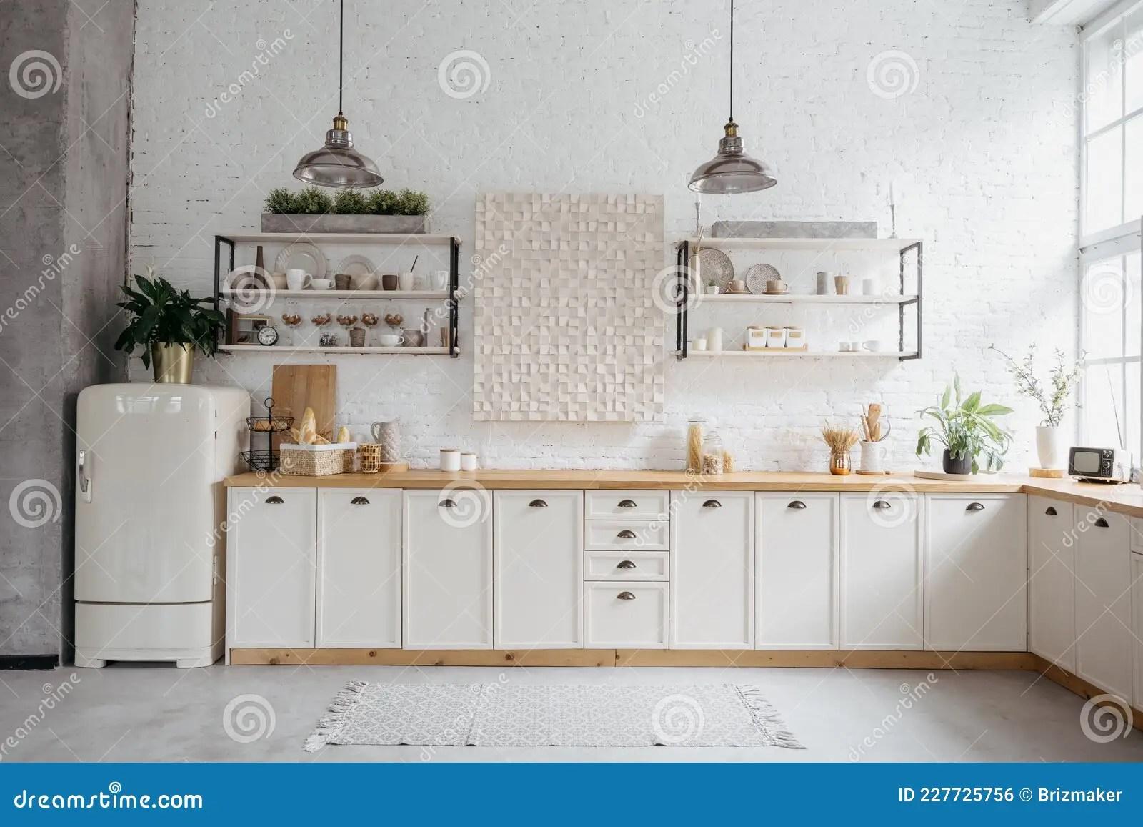Il primo elemento distintivo di una cucina country chic sono i mobili. Rustic Kitchen Interior With White Brick Wall Stock Photo Image Of Copy House 227725756