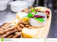 Rustic Presentation Of Cheese And Cracker Platter Stock