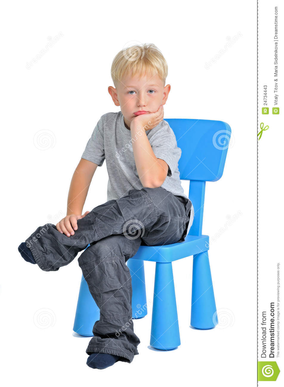 Sad boy sitting on a chair stock image Image of cutout