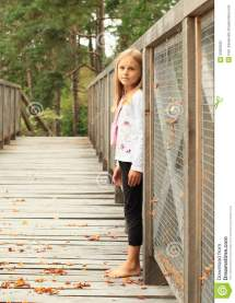 Little Girls Barefoot On Bridge