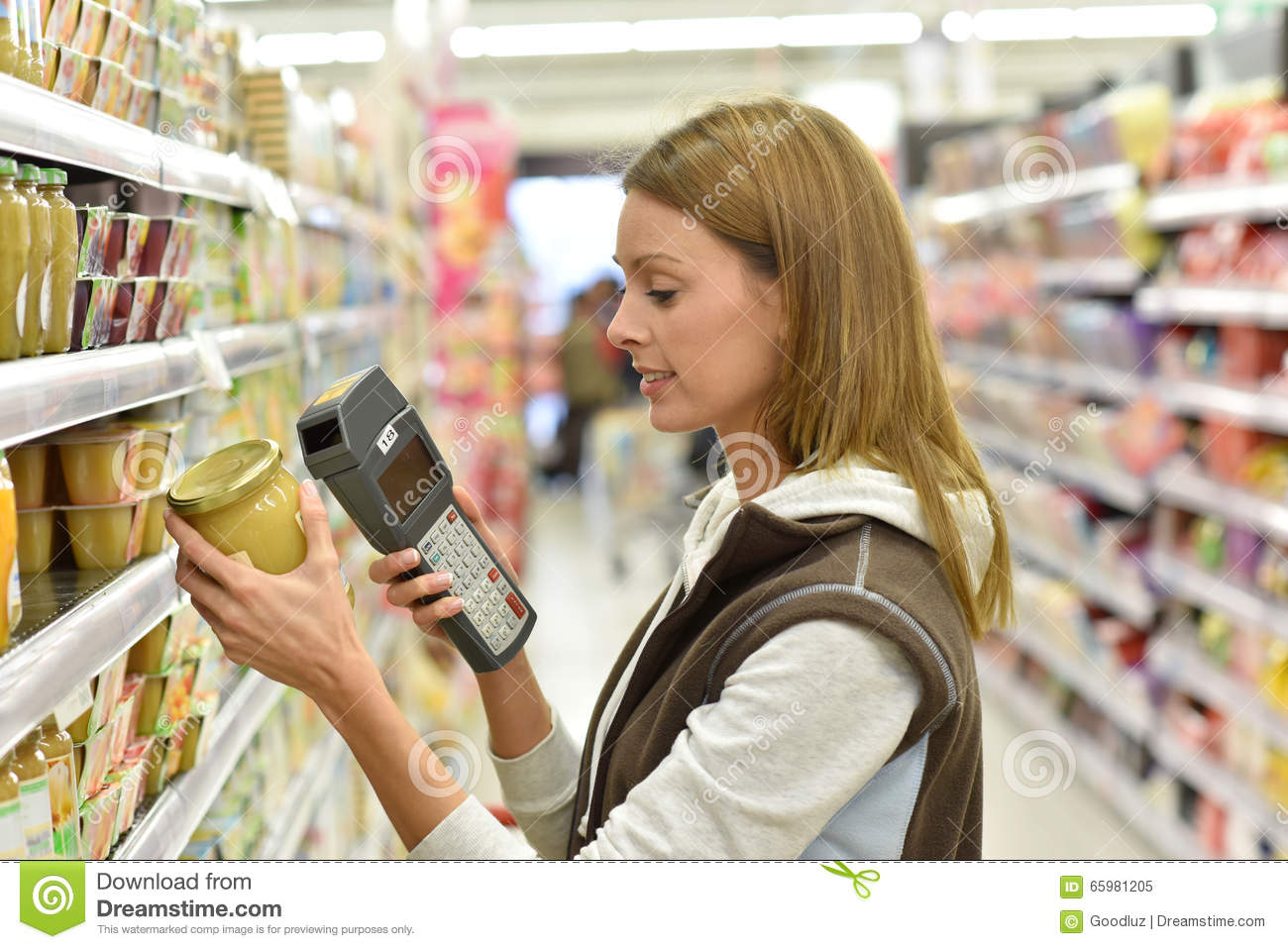 Sales Assistant In Grocery Store Scanning Products Stock Image  Image of machine reading 65981205