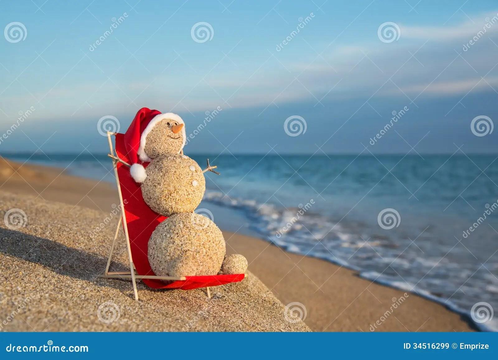 Sandy Snowman Sunbathing In Beach Lounge Holiday Concept