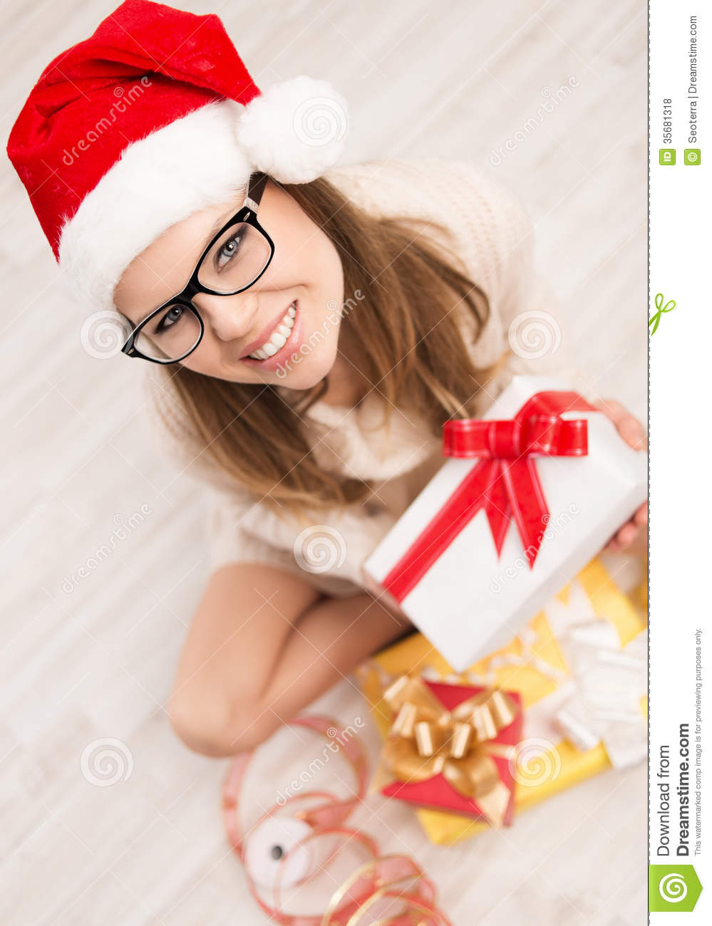 Santa Girl With Christmas Gift Royalty Free Stock Photos