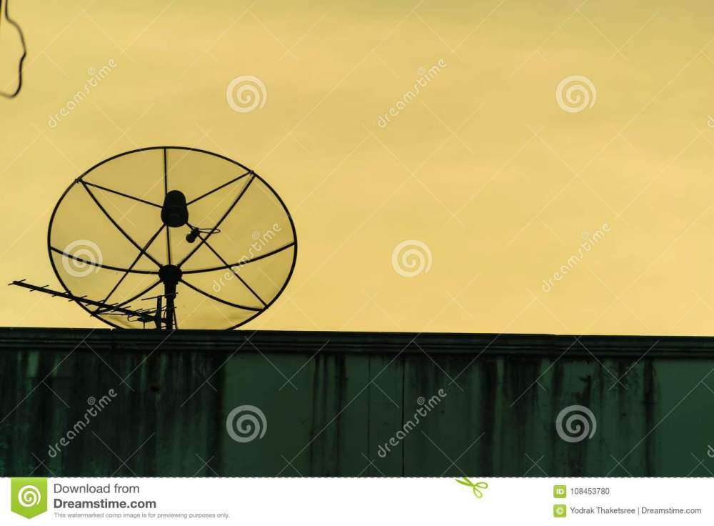 medium resolution of satellite dish silhouette communication antena radio for tv on building brick with gold sky background