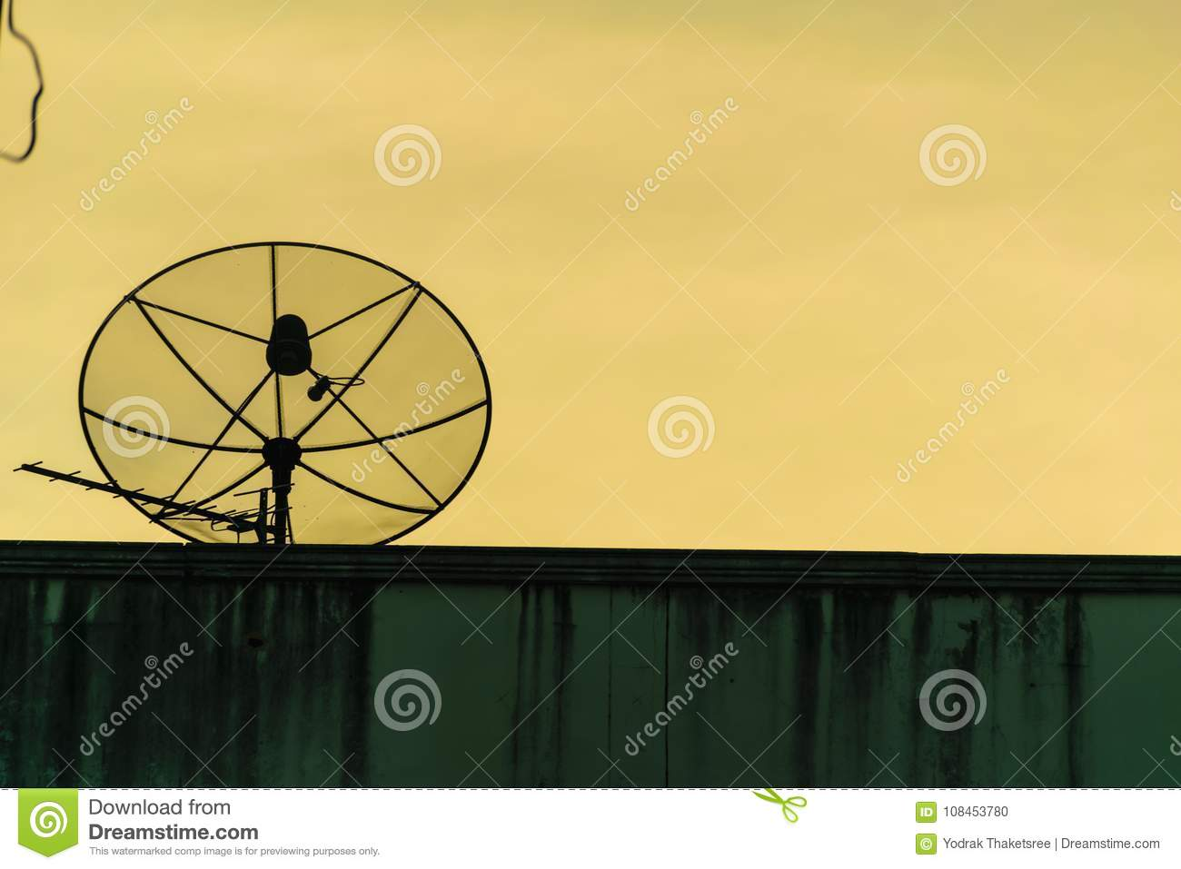 hight resolution of satellite dish silhouette communication antena radio for tv on building brick with gold sky background